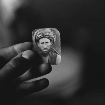 Afghanistan (Abdul Aziz holding a photograph of his brother, Mula Abdul Hakim) 1997