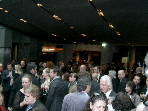 Opening night crowd at NGV International for the Andreas Gursky exhibition