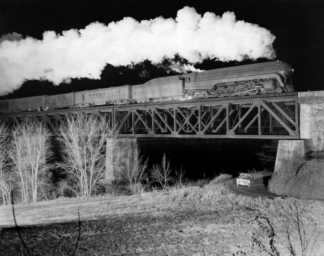 "O. Winston Link (American, 1914-2001) '""The Birmingham Special Crosses Bridge 201,"" near Radford, Va., Dec. 17, 1957'"