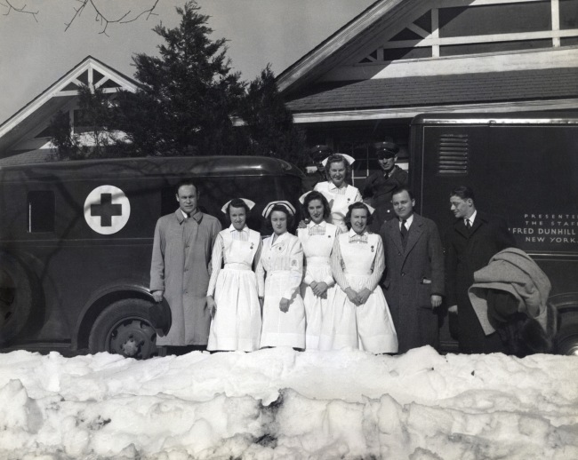 Addison Scurlock(American, 1883-1964) 'Charles Drew with the first mobile blood collecting unit [Charles Drew and Red Cross Medical Team]' February 1941