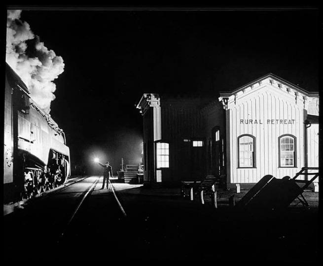 O. Winston Link(American, 1914-2001) 'NW1635, The Birmingham Special, arriving at Rural Retreat, Va.' 1957