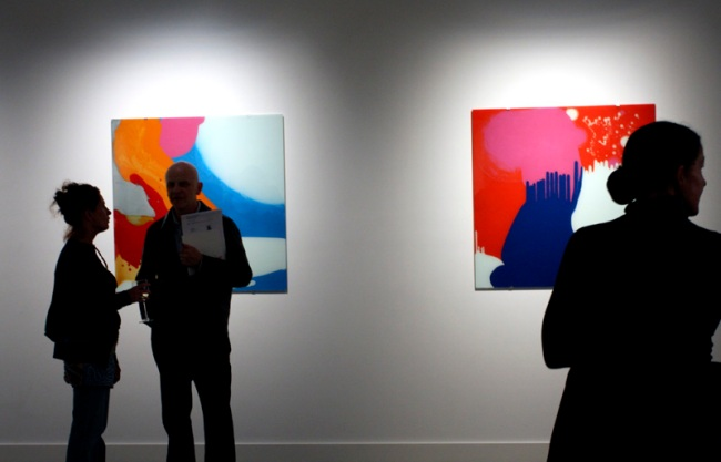 Louise Paramor. Opening night crowd in front of 'Sky Pilot' (left) and 'Mama' (right) 2009