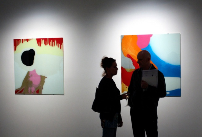 Louise Paramor. Opening night crowd in front of 'Green Eyed Monster' (right) and 'Sky Pilot' (right) 2009