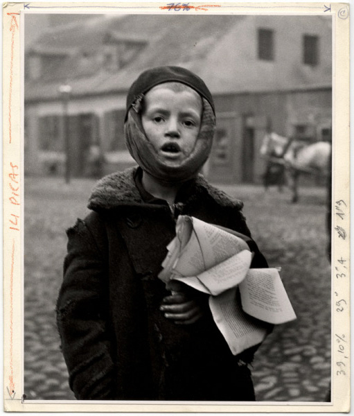 Roman Vishniac. 'A Boy with a toothache. Next year another child will inherit the tattered schoolbook. Slonim' ca 1935-38