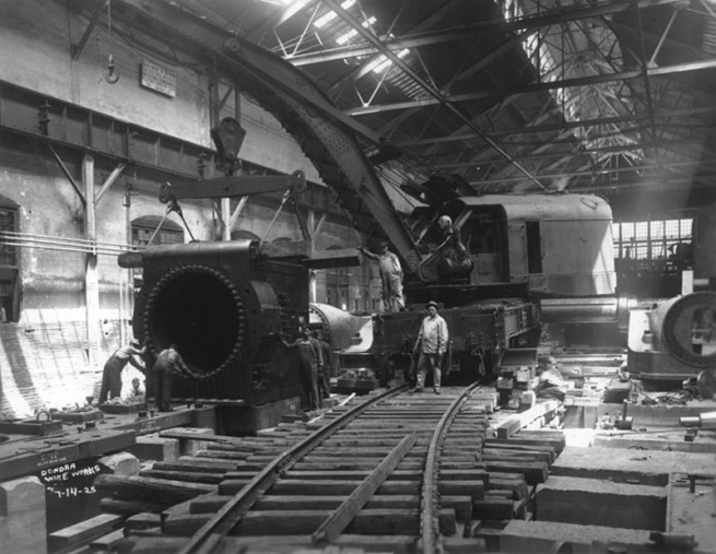 Workers and crane inside the Wire Works, July 14, 1925