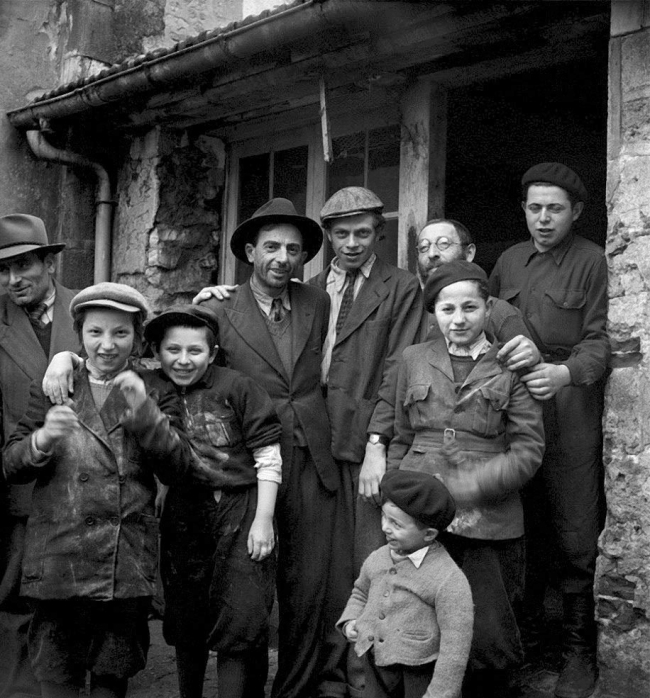 Roman Vishniac (1897-1990) 'Holocaust survivors gathering outside a building where matzoh is being made' 1947