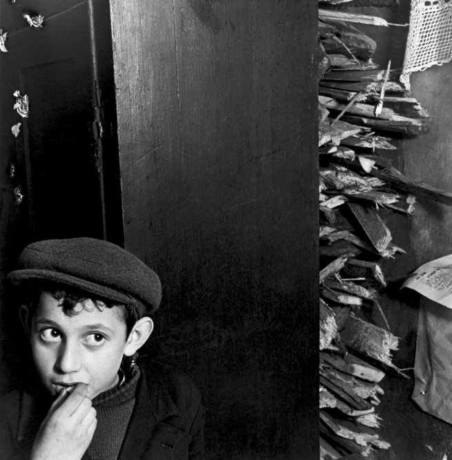 Roman Vishniac (1897-1990) 'Boy with kindling in a basement dwelling, Krochmalna Street, Warsaw' c. 1935-38