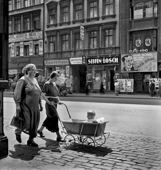 Roman Vishniac (1897-1990) 'Women walking with a baby carriage' 1935