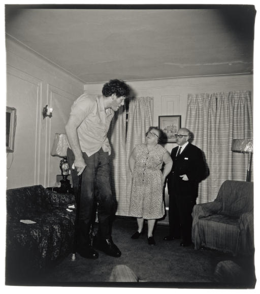 Diane Arbus. 'A Jewish Giant at home with his parents' 1967