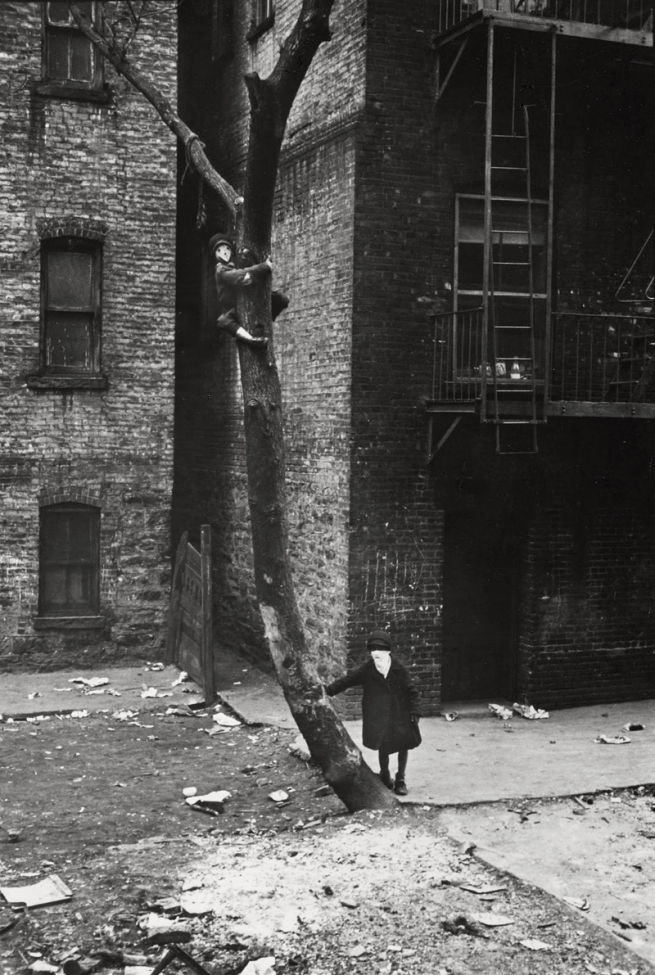 Helen Levitt (American, 1913-2009) 'Kid in Tree with Mask, New York' c. 1942