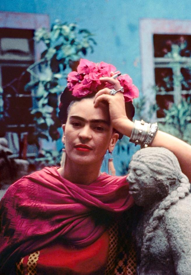 Nickolas Muray(American, 1892-1965) 'Frida leaning on a sculpture by Mardonio Magaña, Coyoacán, Mexico' 1940