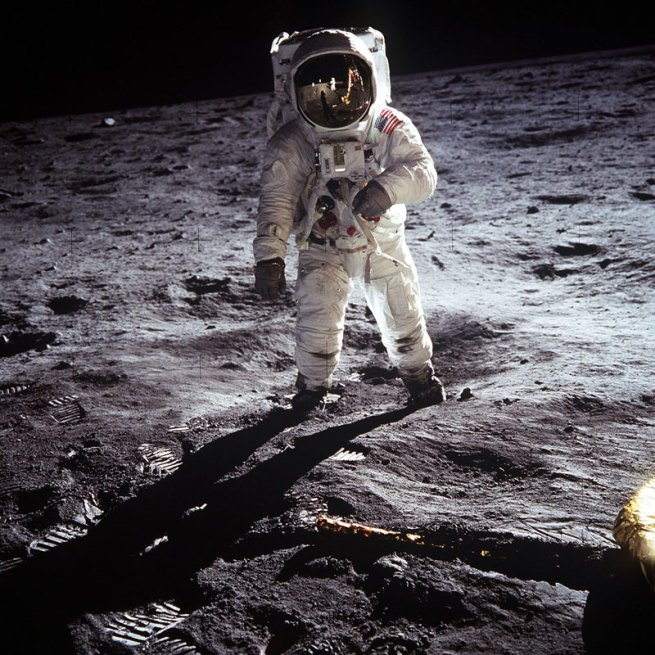 Neil Armstrong. 'Astronaut Buzz Aldrin, lunar module pilot, walks on the surface of the Moon near the leg of the Lunar Module (LM)' 1969