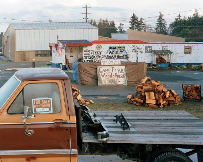 Eirik Johnson(American, b. 1974) 'Adult books, firewood and truck for sale, Port Angeles, Washington' 2006-2008