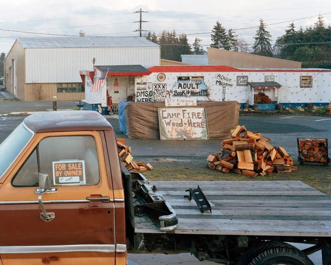 Eirik Johnson (American, b. 1974) 'Adult books, firewood and truck for sale, Port Angeles, Washington' 2006-2008