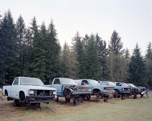 Eirik Johnson. 'Junked Blue Trucks, Forks, Washington' from the series Sawdust Mountain