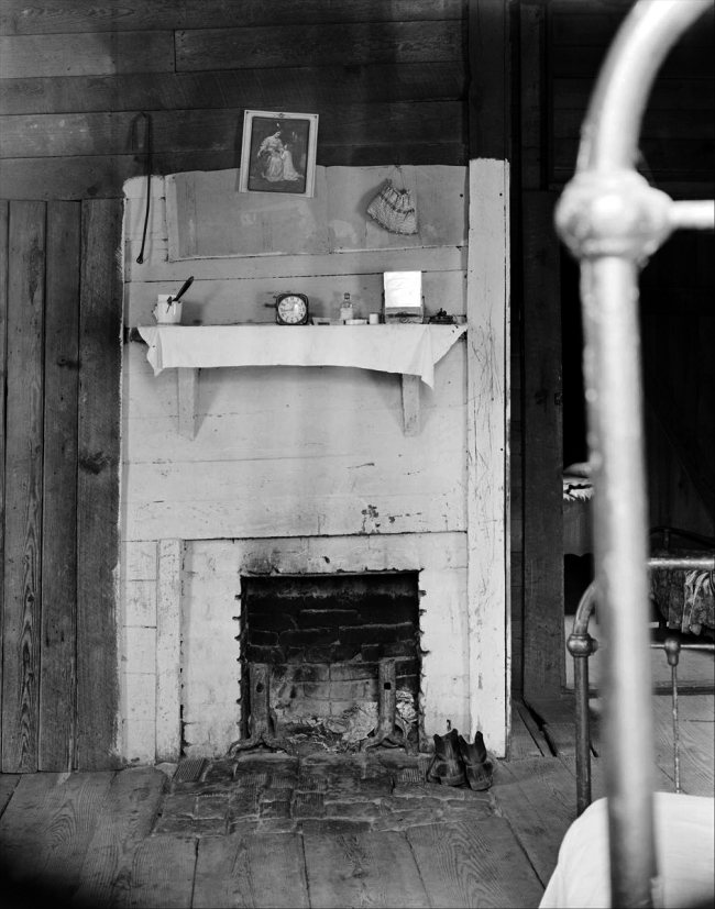 Walker Evans (American, 1903-1975) '[Fireplace in Floyd Burrroughs's Bedroom with Bedpost in Foreground, Hale County, Alabama]' 1936