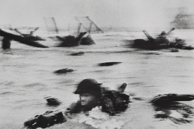 Robert Capa. 'Omaha Beach, near Colleville-sur-Mer, Normandy coast, June 6, 1944. The first wave of American troops landing on D-Day' 1944