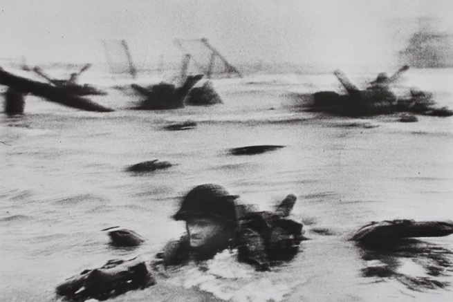 Robert Capa. 'Omaha Beach, near Colleville-sur-Mer, Normandy coast, June 6, 1944. The first wave of American troops landing on D-Day.' 1944