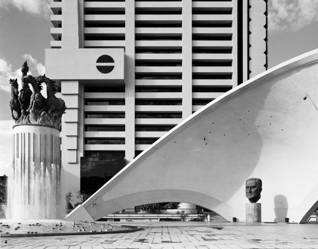 David Goldblatt. 'Monuments celebrating the Republic of South Africa (left and JG Strijdom, former prime minister (right), with the headquarters of Volkskas Bank, Pretoria. 25 April 1982' 1982