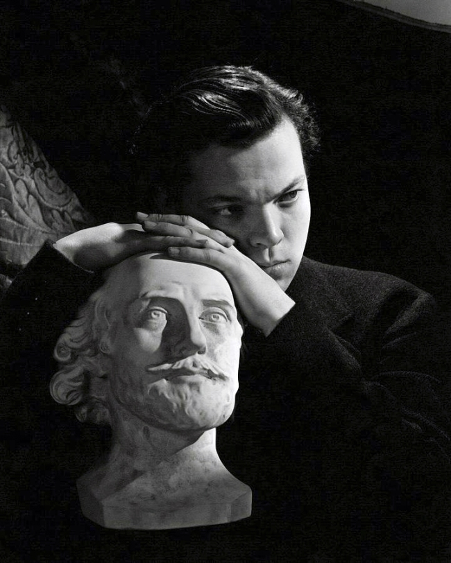 Cecil Beaton (British, (1904-1980) 'Orson Welles resting on a sculpture' 1942