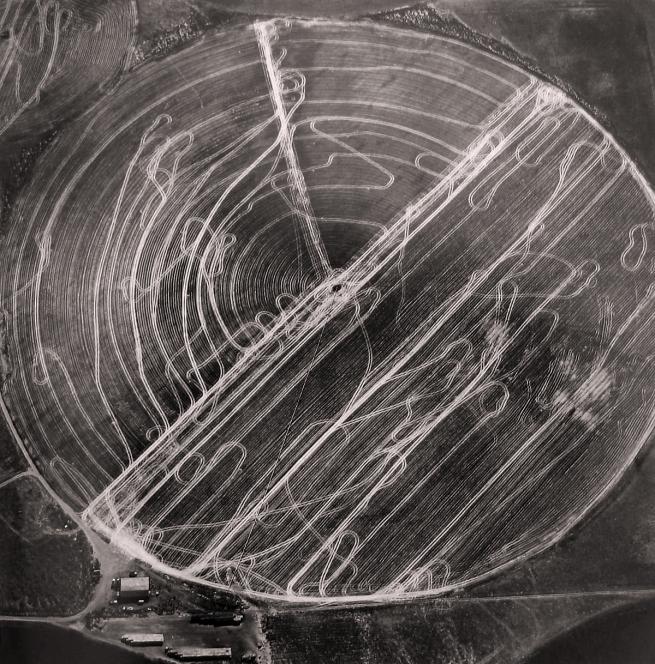 Emmet Gowin. 'Harvest traffic over agricultural pivot near Hermiston, Orgeon, 1991' 1991