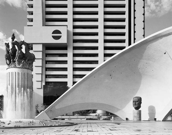 David Goldblatt (South African, 1930-2018) 'Monuments celebrating the Republic of South Africa (left and JG Strijdom, former prime minister (right), with the headquarters of Volkskas Bank, Pretoria. 25 April 1982' 1982