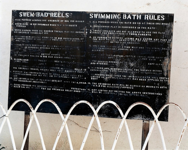 David Goldblatt. 'The swimming bath rules at the rec, Cape Blue Asbestos Mine, Koegas, Northern Cape' 2002