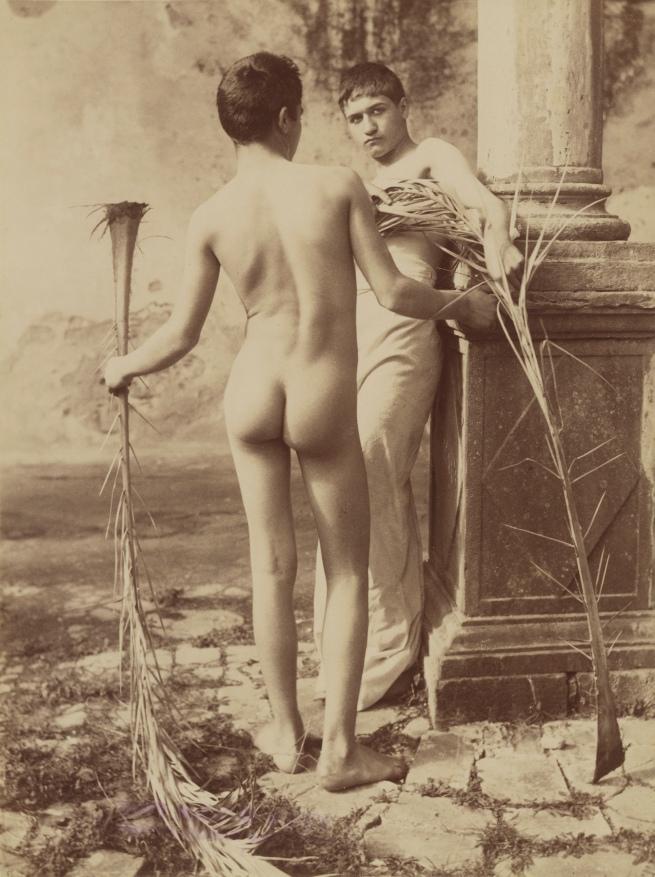 Baron Wilhelm von Gloeden (German, 1856-1931) 'Untitled [Two Male Youths Holding Palm Fronds]' c. 1885 - 1905