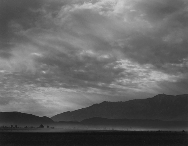 Ansel Adams. 'View SW over Manzanar, dust storm, Manzanar Relocation Center' 1943