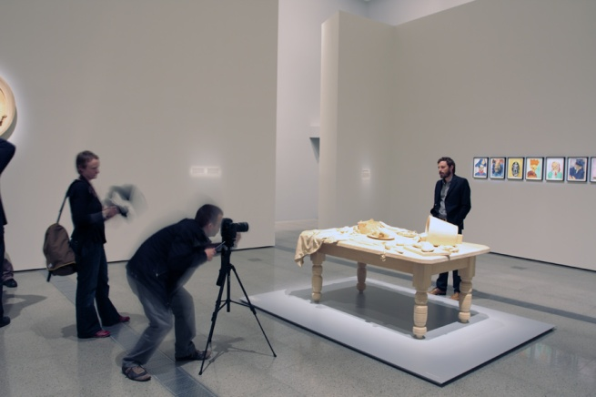 Ricky Swallow facing the media behind his work 'Killing time' (2003 - 04)