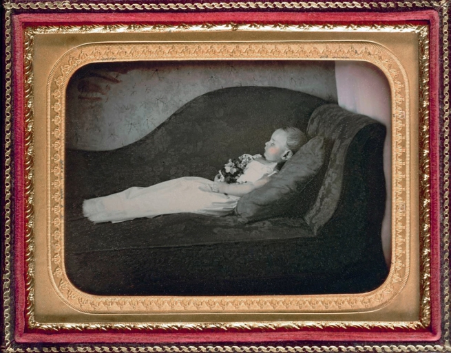 Unknown photographer (American) 'Dead child on a sofa' c. 1855