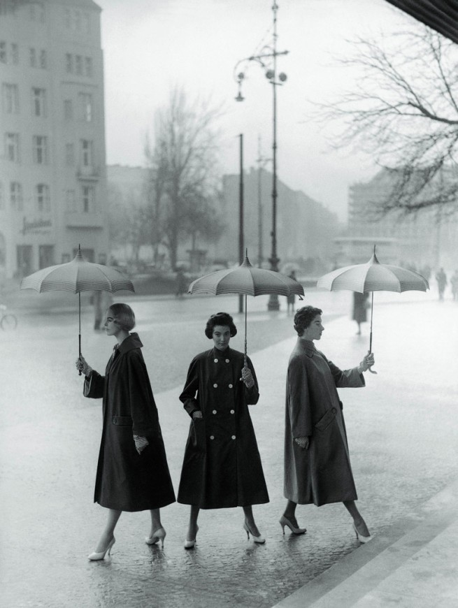 F.C. Gundlach (German, b. 1926) 'Rainweather, party sunshiny. Three poplin coats by Staebe-Seger' Berlin 1955