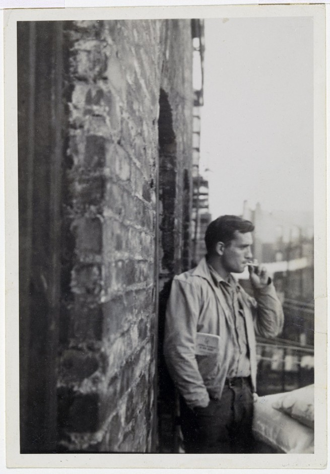 Allen Ginsberg. 'Jack Kerouac, railroad brakeman's rule-book in pocket…206 East 7th Street near Tompkins Park, Manhattan, probably September 1953' 1953