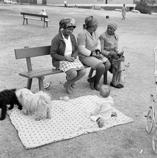 David Goldblatt. 'Baby with childminders and dogs in the Alexandra Street Park, Hillbrow, Johannesburg, 1972'