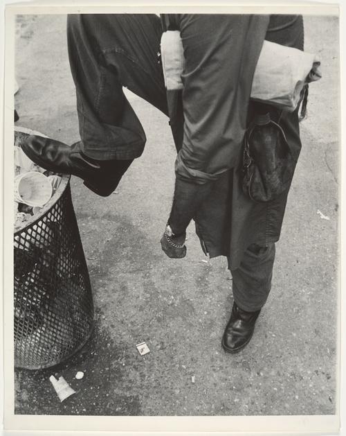Leon Levinstein. 'Street Scene - Man Resting Foot on Lip of Trashcan, New York City' 1970s