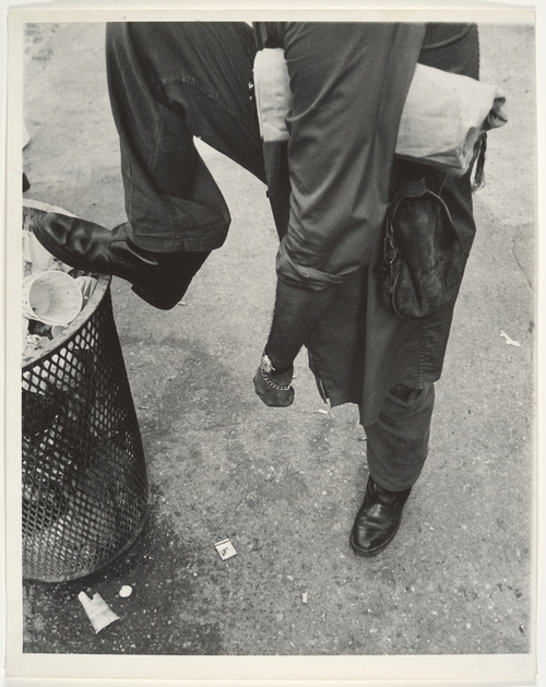 Leon Levinstein. 'Street Scene - Man Resting Foot on Lip of Trashcan, New York City' 1970s