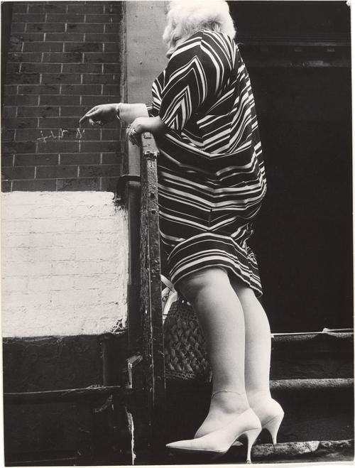 Leon Levinstein. 'Street Scene - Woman in Striped Dress on Stoop, New York City' 1970s