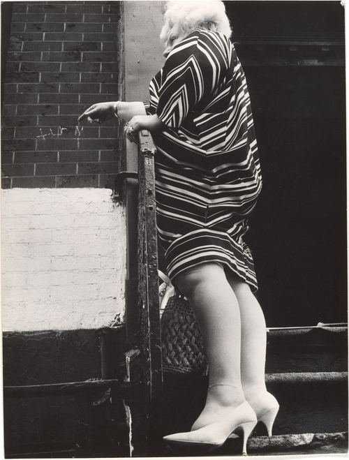 Leon Levinstein. 'Street Scene - Woman in Striped Dress on Stoop, New York City' 1970s