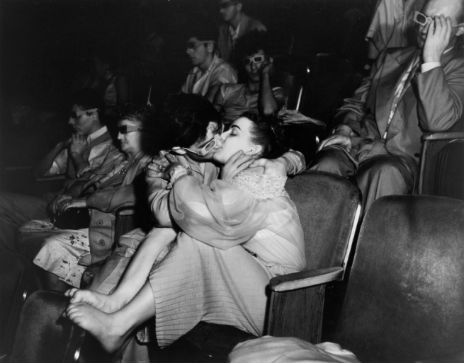 Weegee (Arthur Fellig) (American, born Austria, 1899-1968) '[Lovers at the Movies, Times Square]' c. 1953
