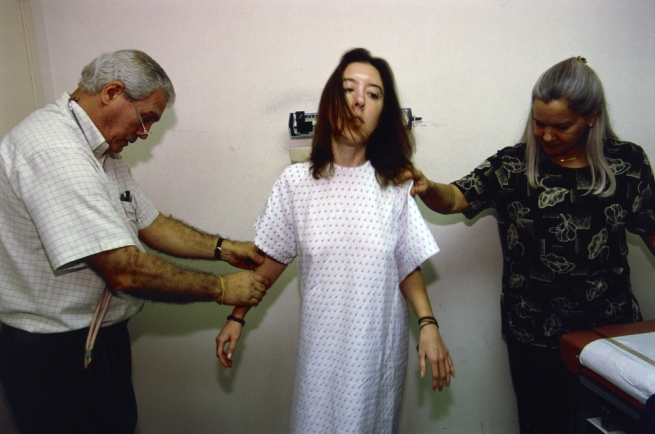 Lauren Greenfield (American, born 1966). Erin, 24, is blind-weighed at an eating-disorder clinic, Coconut Creek, Florida. She has asked to mount the scale backward so as not to see her weight gain' negative 2001; print 2002