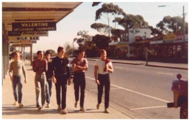 Larry Jenkins. 'Chad, Jono and Mig, Twig, Beatie and Whitey walking down the street at Blackburn South shops' 1975