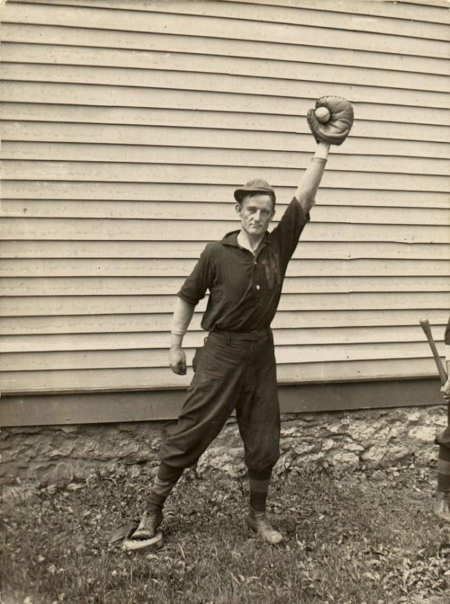 Unknown Artist, American School. '(Man Holding Baseball in Catcher's Mitt)' 1910