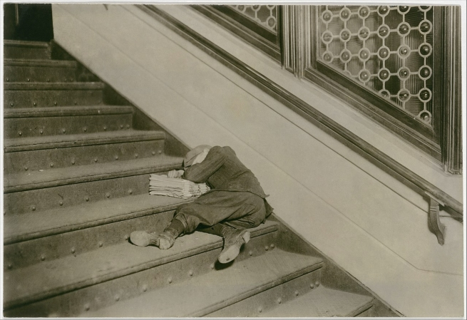 Lewis Hine (American, 1874-1940) 'Newsboy asleep on stairs with papers, Jersey City, New Jersey' February 1912