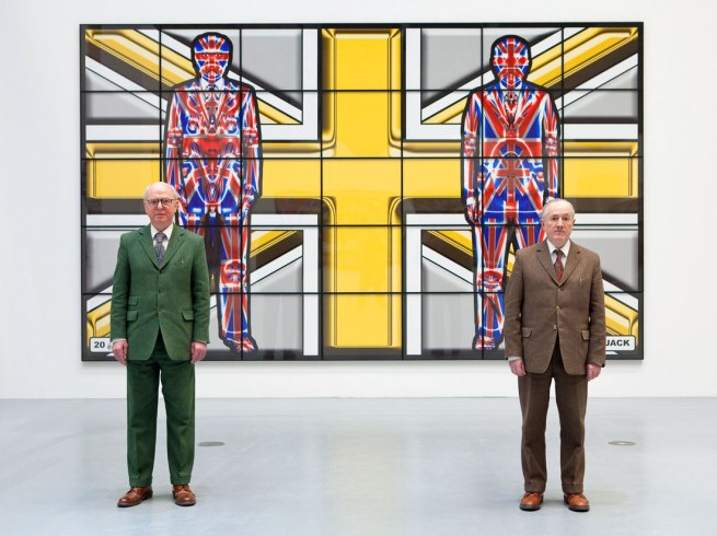 Gilbert & George standing in front of 'Metal Jack' (2008) from the series 'Jack Freak Pictures' on show at Deichtorhallen Hamburg