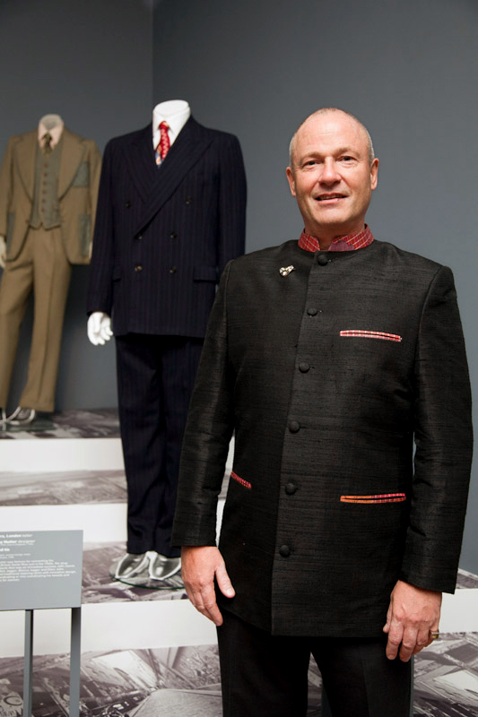 Dr Marcus Bunyan at the opening of Manstyle in front of a two-piece c. 1949 Simpsons of Picadilly, London blue pin-stripped suit and 1940's tie from his collection
