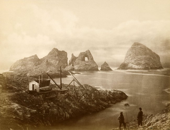 Eadweard Muybridge. 'The Ramparts, Funnel Rock, Hole in the Wall, Pyramid, Sugar Loaf, Oil House, and Landing Cove on Fisherman's Bay, South Farallon Island (4150)' 1871