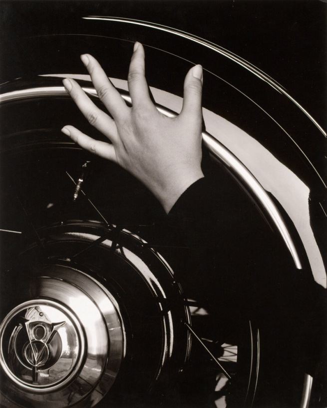 Alfred Steiglitz. [Georgia O'Keefe hand on back tire of Ford V8] 1933