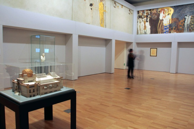 Installation view of room three of the exhibition 'Vienna - Art & Design' at the National Gallery of Victoria showing part of Gustave Klimt's 'Beethoven Frieze: Central wall' 1901-02 (detail at top)