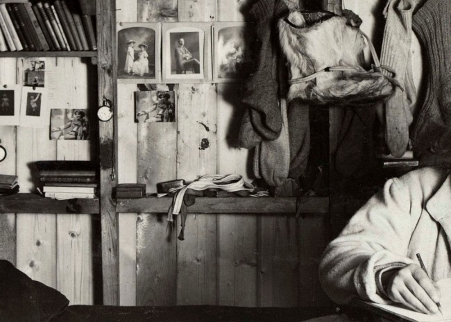 Herbert Ponting(British, 1870-1935) 'Scott writing in his area of the expedition hut, Scott's cubicle' (detail) 1911