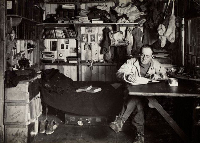 Herbert Ponting(British, 1870-1935) 'Scott writing in his area of the expedition hut, Scott's cubicle' 1911